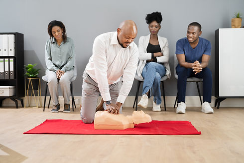 CPR First Aid Lifeguard Or Paramedic Class With African Students.jpg