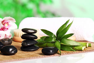 spa-wellness-massage-stones-flowers-wood
