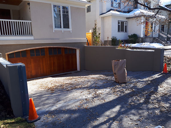 Retaining wall acrylic stucco repair finished work