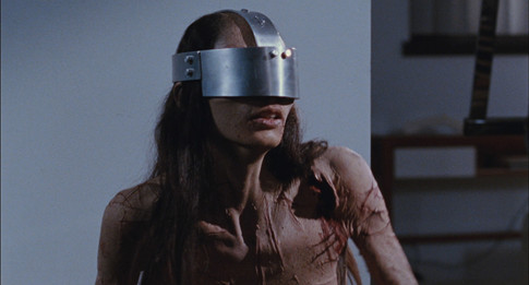 Horror film Martyrs scene with girl with metal torture device on face