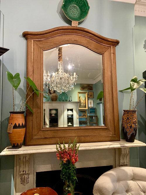 Oak mantle mirror. Bevelled glass