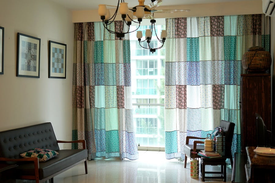 Floor to ceiling patchwork curtains for the living room.
