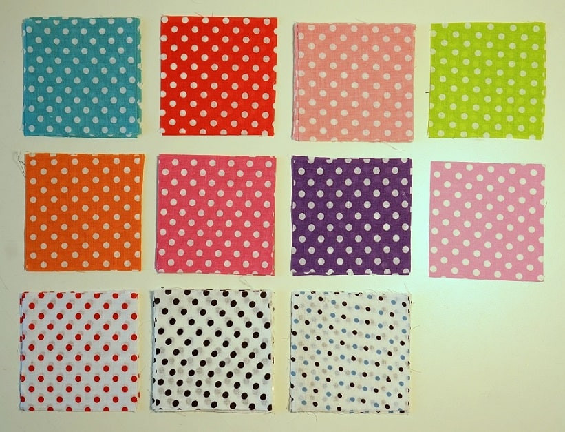 Big polka-dots fabric squares arranged in grid.