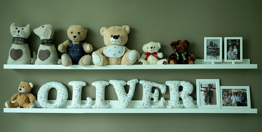 Stuffed fabric letters on IKEA wall shelves.