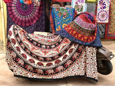Colourful ethnic fabrics displayed in a textile shop in Jaipur, India.