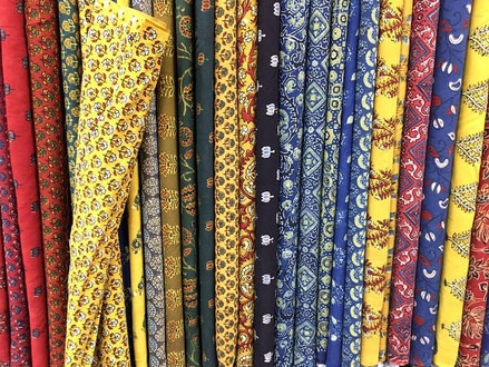 Colourful ethnic fabric on display in a textile shop in Kolkata, India.