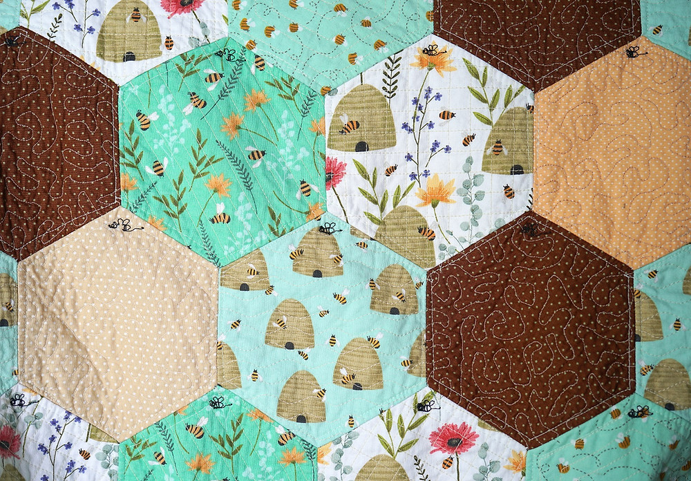 hexagon quilt quilting patterns stitch by the ditch QAYG