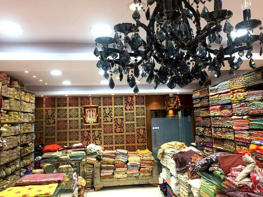 Fabric store in Kolkata, India with beautiful black chandelier.
