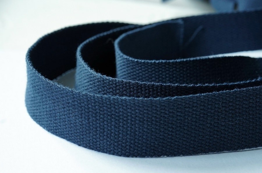 Dark blue cotton webbing.