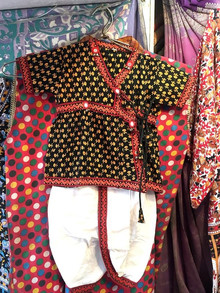 Children's ethnic wear in a textile shop in Jaipur, India.