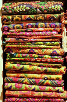 Stack of colourful ethnic fabric in a textile shop in Jaipur, India.