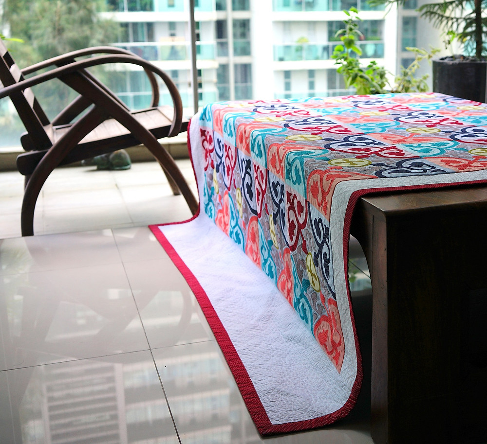 Peranakan Tiles Applique Quilt Draped on Table