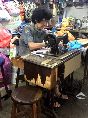 The last generation of tailors working on customers' orders at Kee Ann Road, Malacca.