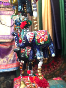 Colourful hanging garland with elephant figurine sold in a textile shop in Jaipur, India