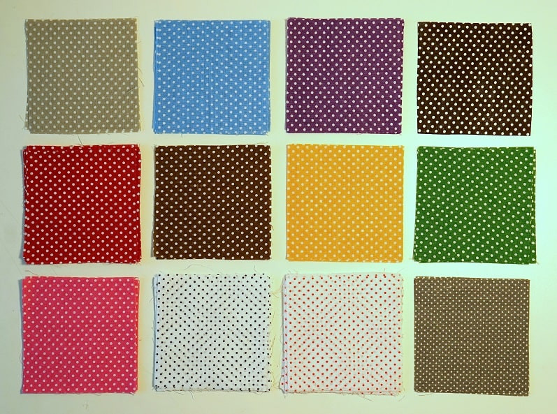 Polka-dots fabric squares arranged in grid.