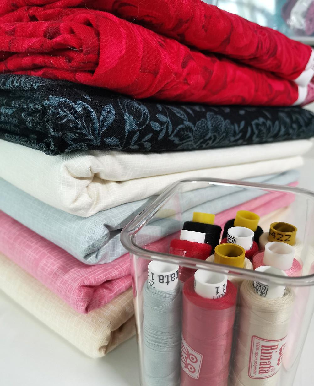 Red white grey beige black fabrics and threads