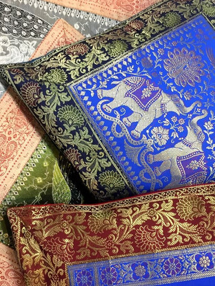 Colourful ethnic brocade cushion covers in a textile shop in Varanasi, India.