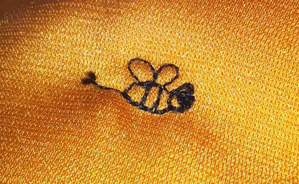 bee decorative machine stitch close up