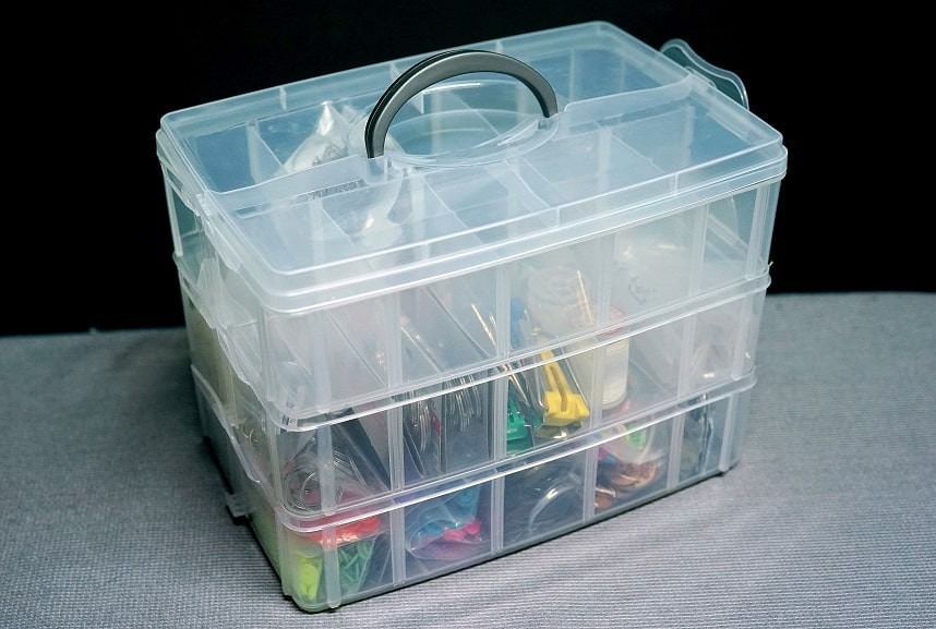 Three-tiered compartmental box to store sewing notions.