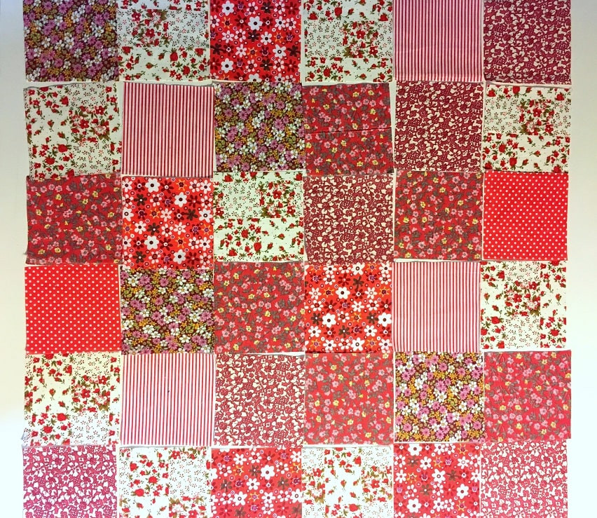 Red fabric squares arranged 6 by 6.