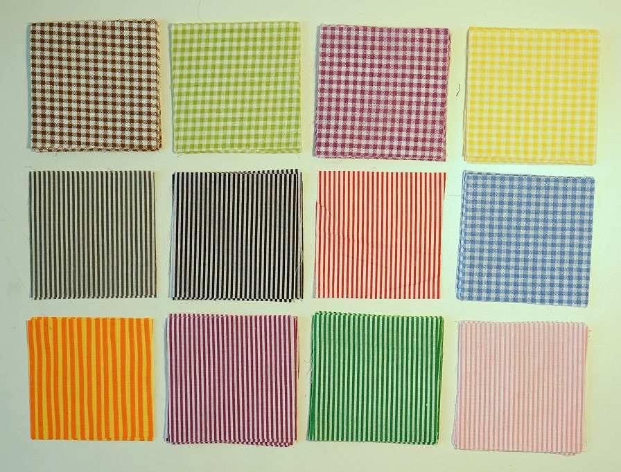 Gingham and striped fabric squares arrange in grid.