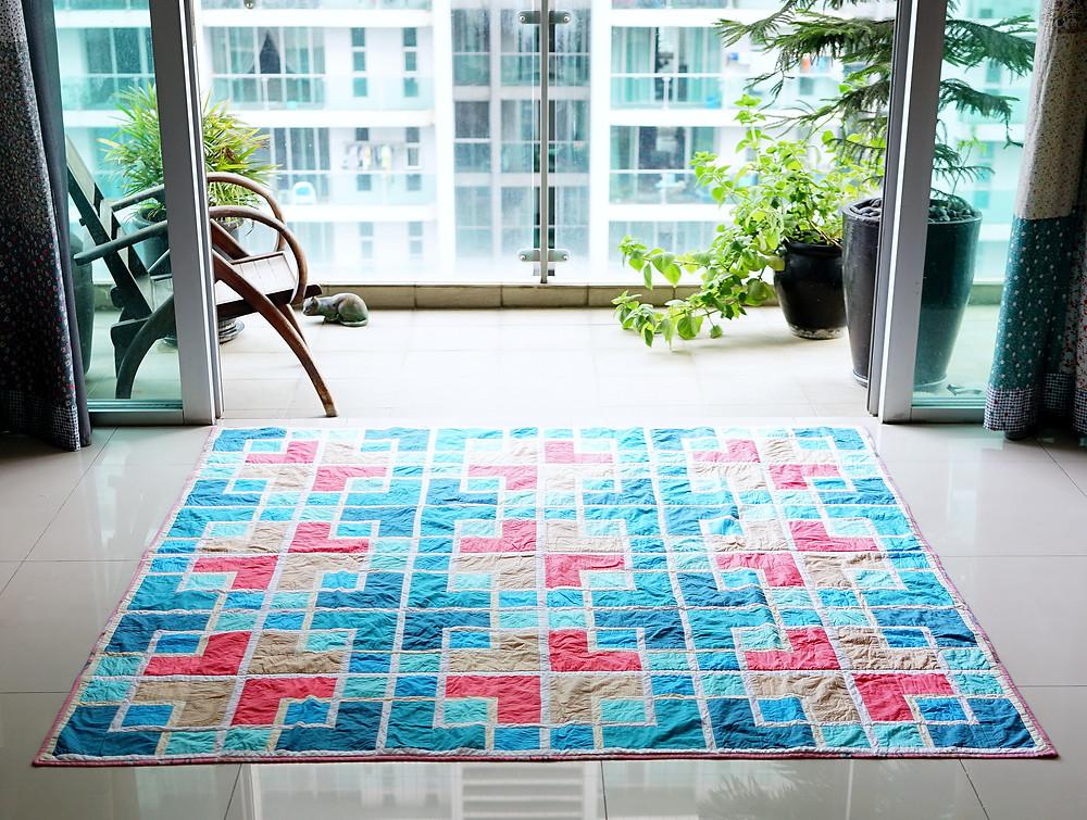 colourful oriental lattice quilt on floor