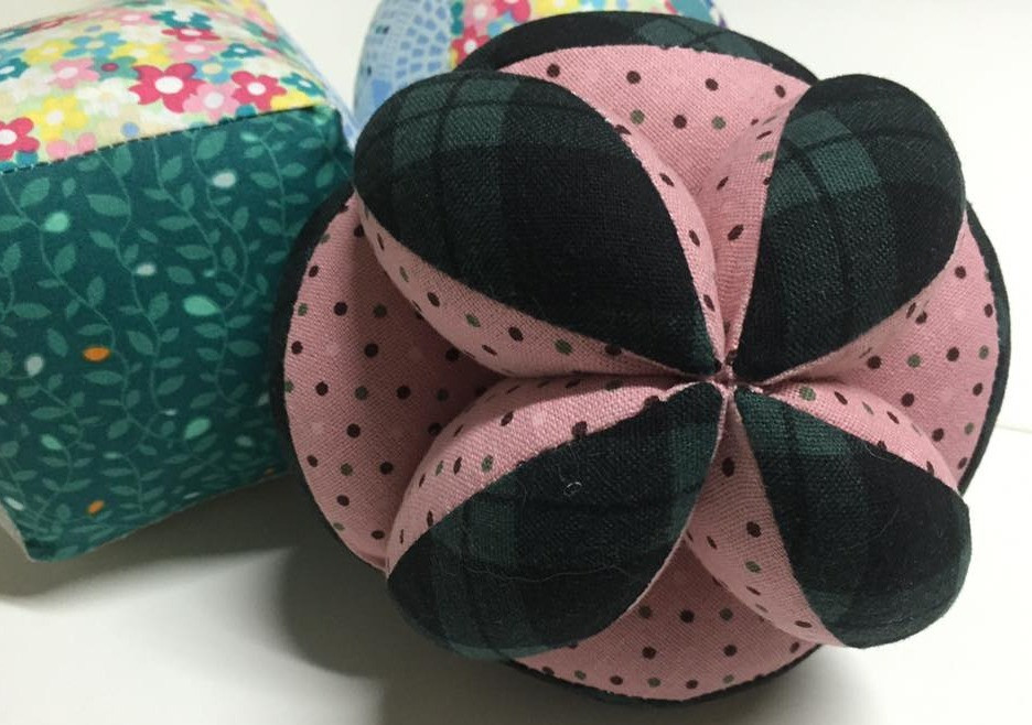 Fabric Amish puzzle ball, fabric patchwork cube, and fabric patchwork ball.