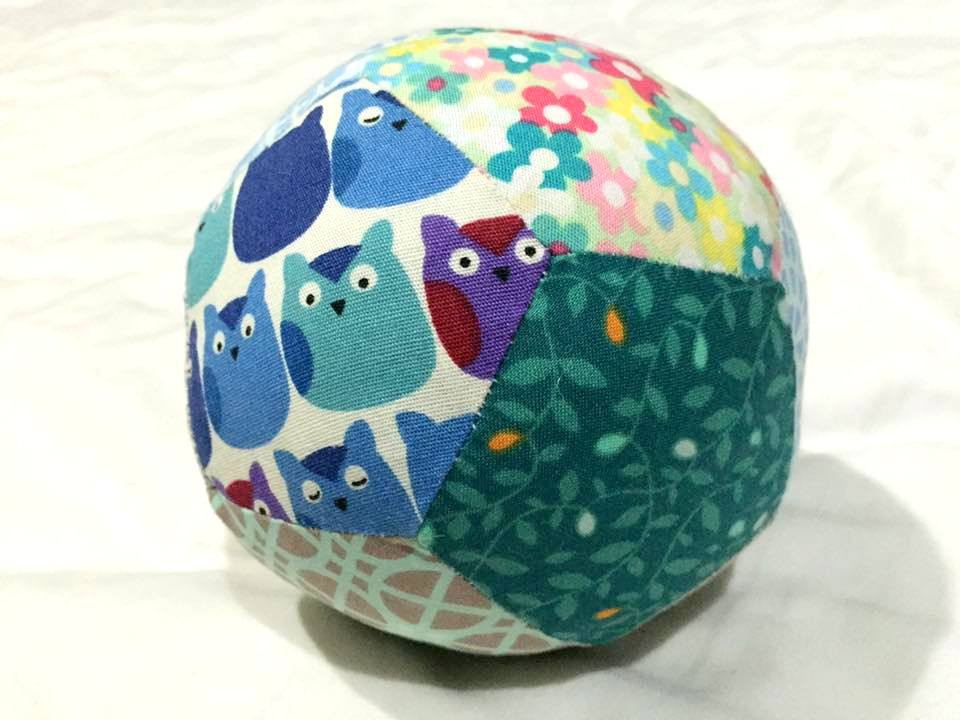 Fabric patchwork ball made up of pentagons.