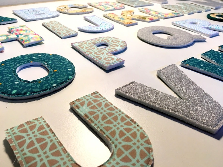 Fabric alphabets with polyester batting.