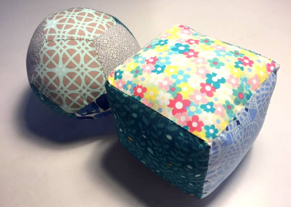 Fabric patchwork cube and fabric patchwork ball.