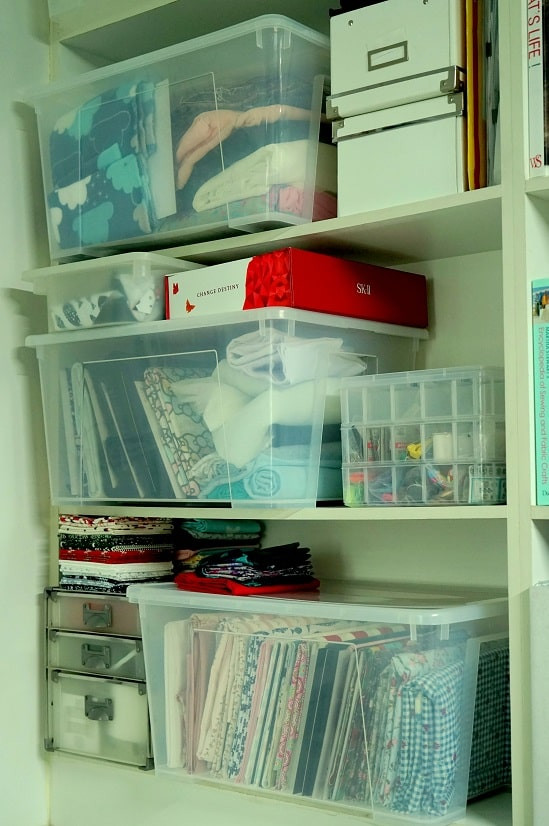 Fabrics and sewing stuff stored in cabinet
