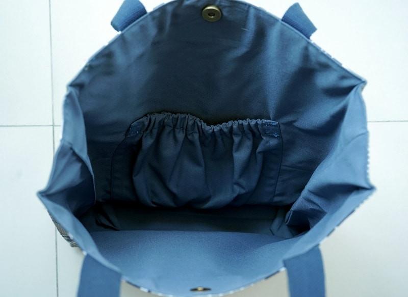 Elastic pocket inside lined tote bag.