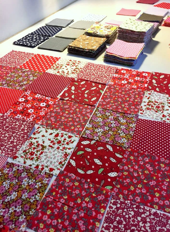 Sorting of fabric squares.