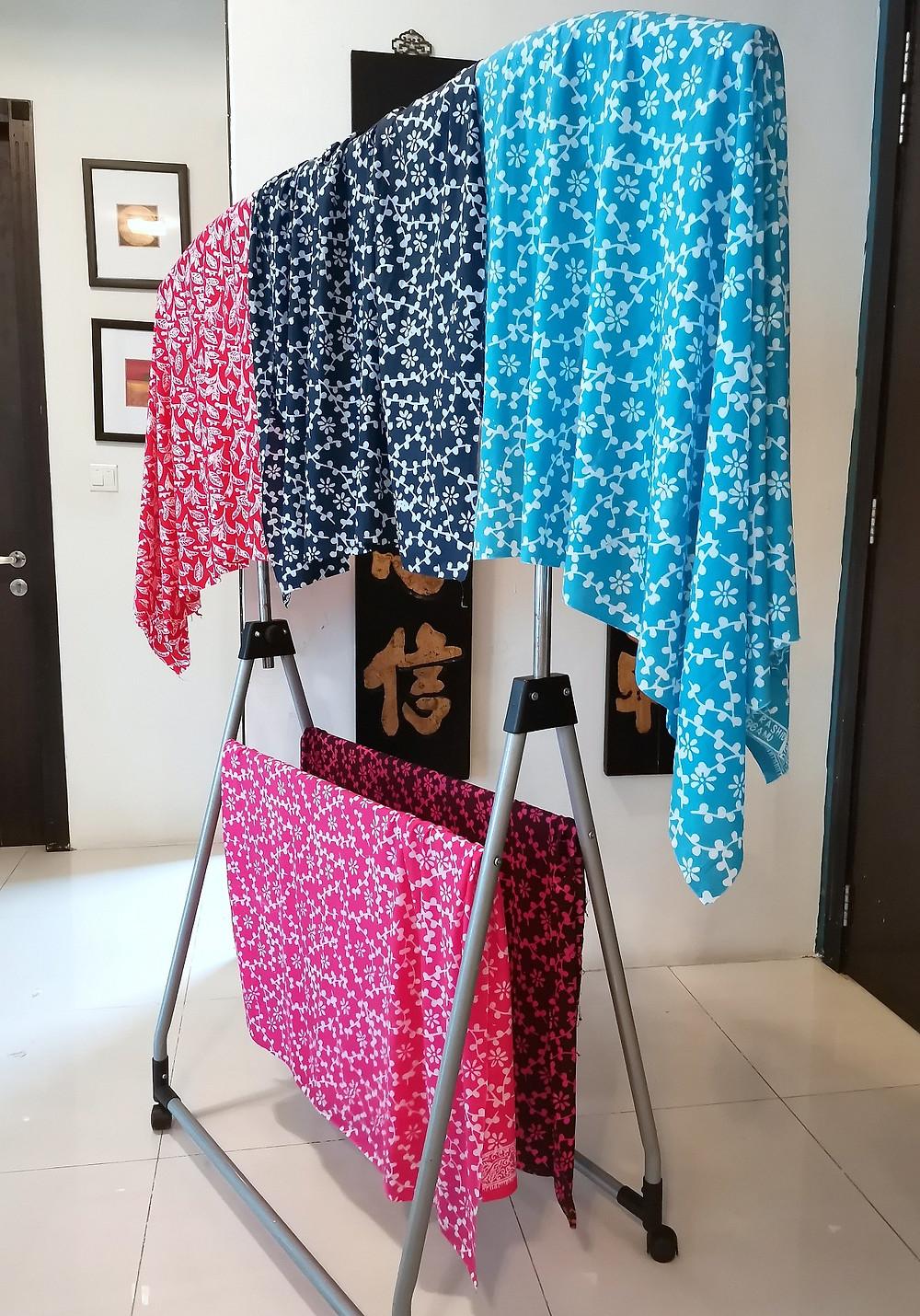 Colourful Terengganu batik fabrics hung to dry starched