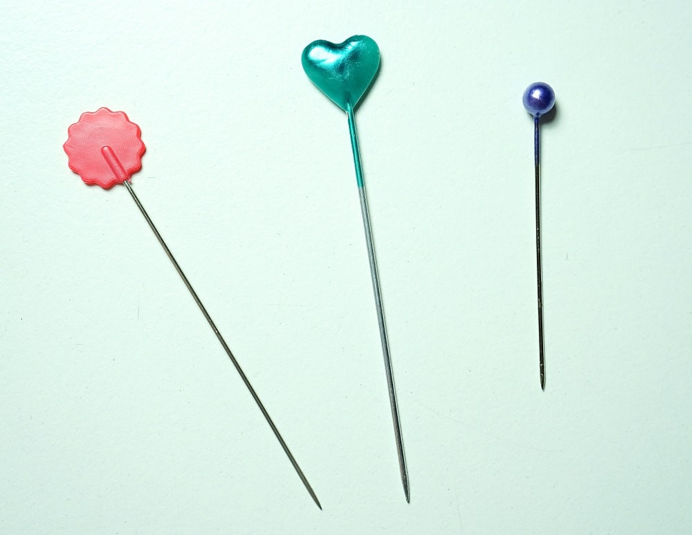 Left to Right:  Flat flower head pin, hearth-shaped head pin, and glass bead pin.