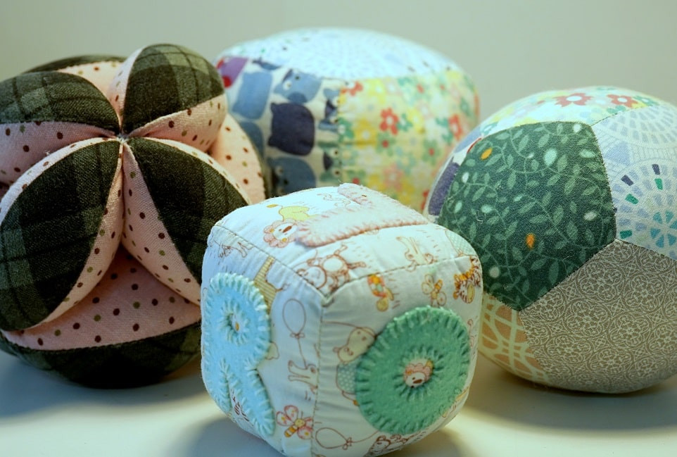 Fabric stuffed cube, ball and Amish puzzle ball