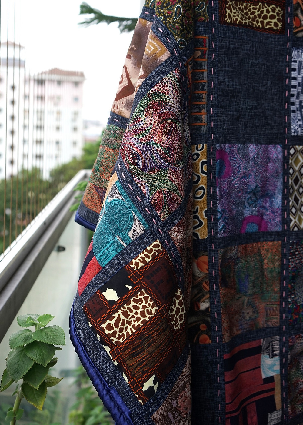 memory square patchwork quilt hang on rack outdoor