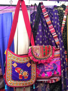 Colourful ethnic sling bags in a textile shop in Jaipur, India