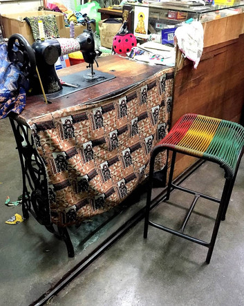 An old sewing machine complemented by a vintage stool inside the cluster of tailor shops at Kee Ann Road.