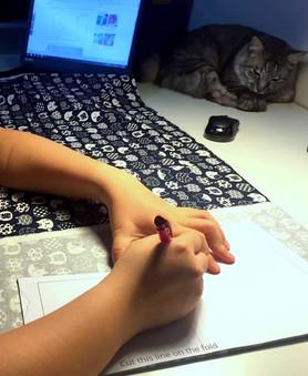 Tracing the baby kimono pattern onto fabric.
