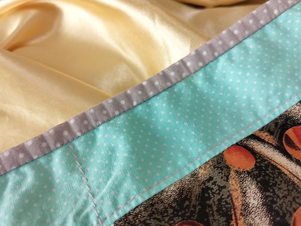 quilt bias binding satin backing close up