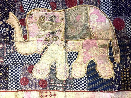Elephant embroidery artwork in a textile shop in Jaipur, India.