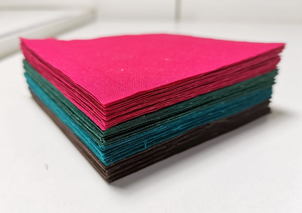 Stack of colourful fabric squares
