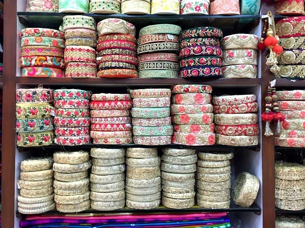 Colourful ethnic lace displayed on shelves in Kolkata, India