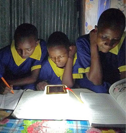 Image of 3 students with solar lanterns_
