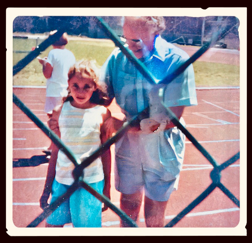 My Grandpa and I walking off the track after the 400m Championship Finals. I was upset to have finished 2nd. Family wasn't allowed on the track, but he was proud of me and snuck on anyway.