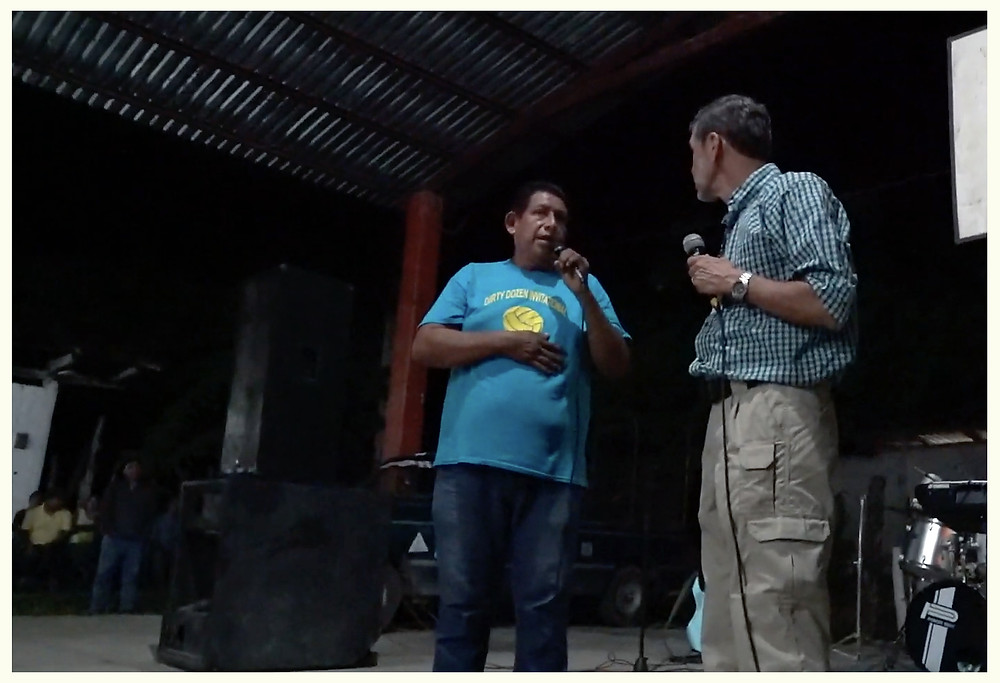 Man being healed by God on stage at an Evangelistic crusade in Mexico.