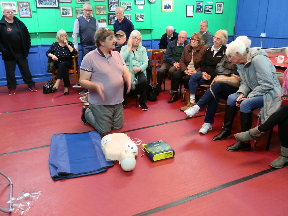 Alan on his knees with Annie as some of the members watch on.