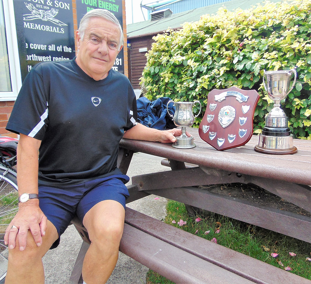 Club Chairman, Ian McElwee, he's got his hands on the trophy!
