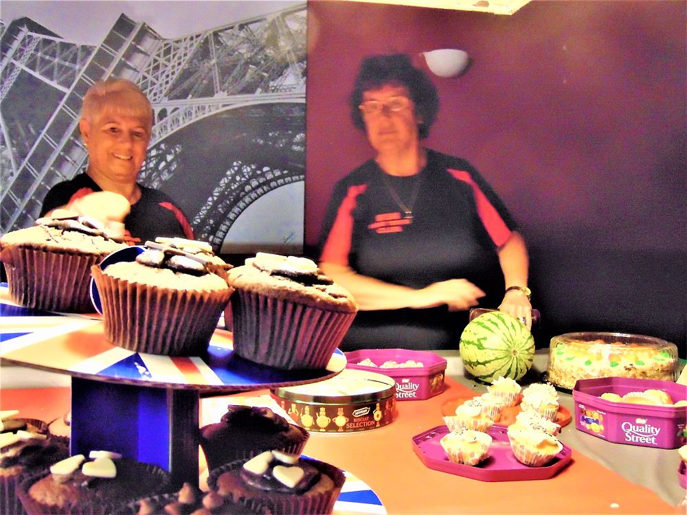 Migs Morris and Elaine Core - guarding the cakes, well they were to die for, delicious!